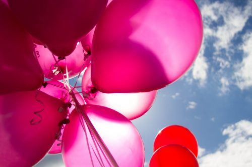 pink balloons clear skies