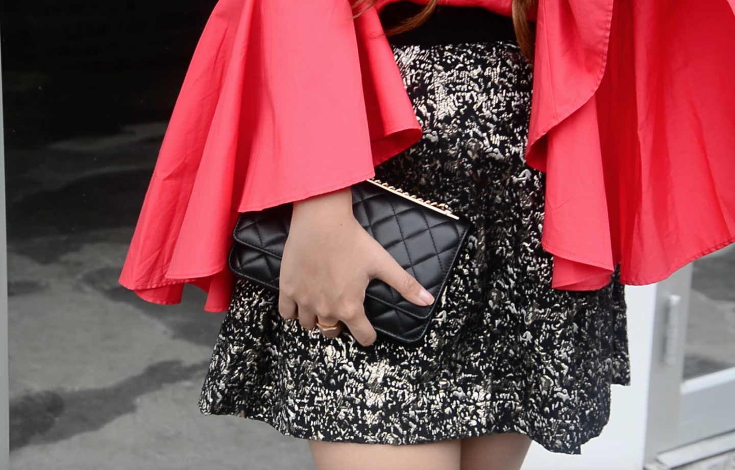 statement sleeves metallic skirt chanel clutch