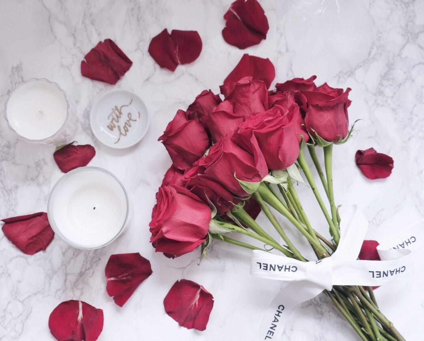 flowers candles flatlay