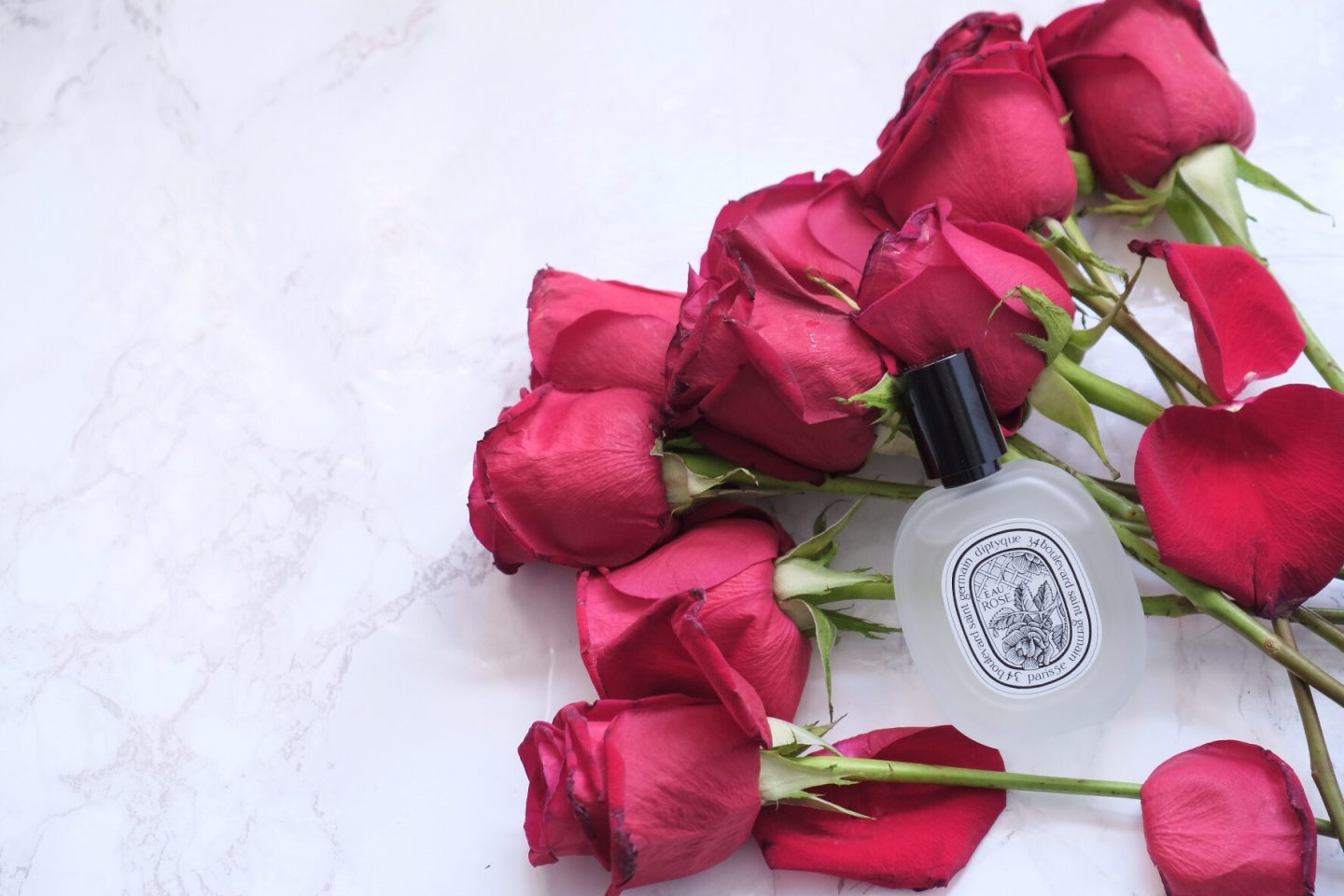 diptyque roses flatlay