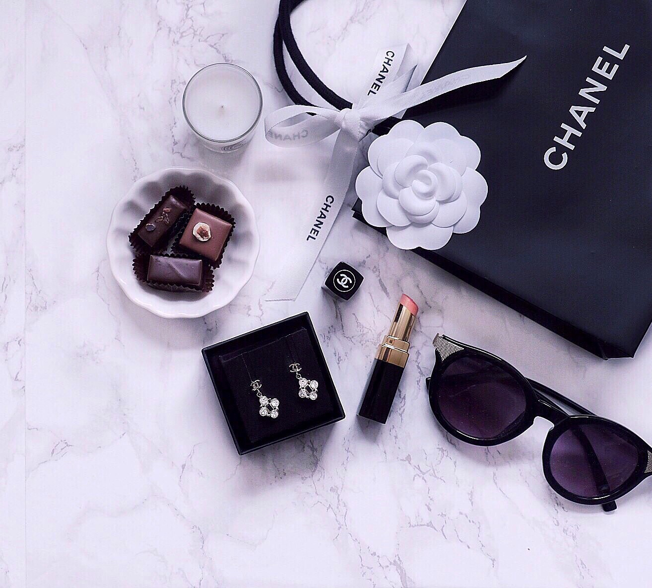 chanel earrings flatlay